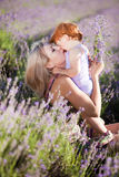 Lavender fairy. Happy mother with red hair little girl in a lavender field Royalty Free Stock Images