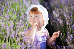 Lavender fairy. Lovely red hair little girl in a lavender field Stock Photo
