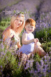 Lavender fairy. Lovely red hair little girl whith her mother in a lavender field Stock Photo