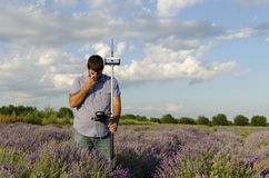 Lavender field and surveyor. During the day stock image