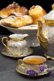 Lavender flavored tea with teapot and sweets Stock Photography