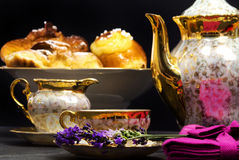 Lavender flavored tea with teapot and sweets Stock Photos
