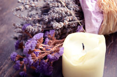 Lavender flower and a candle. Lavender purple flower and aroma candle stock photo