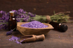 Lavender. Flower,essence and bath salt over a wooden table Royalty Free Stock Photos