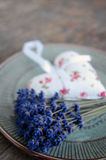 Lavender flower and heart shaped lavender bag Royalty Free Stock Photo