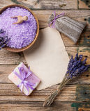 Lavender. Flower, soap, salt, sachet and blank paper on a wooden background Stock Photos
