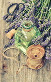 Lavender flowers bouquet with herbal oil and home tools. . Count Royalty Free Stock Photo