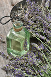 Lavender flowers bouquet with herbal oil and scissors. Alternati Stock Photos