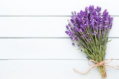 Lavender flowers, bouquet on rustic background, overhead. royalty free stock photos