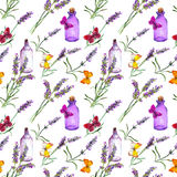 Lavender flowers, oil bottles, butterflies. Seamless pattern for alternative medicine, aromatherapy. Watercolor. Lavender flowers, oil bottles and butterflies Royalty Free Stock Image