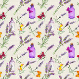 Lavender flowers, oil bottles, butterflies. Seamless pattern for beauty design. Watercolor. Lavender flowers, oil bottles and butterflies. Seamless pattern for Stock Photography