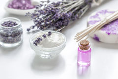 Lavender flowers in organic cosmetic set on white background Stock Photos