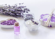 Lavender flowers in organic cosmetic set on white background Stock Photo