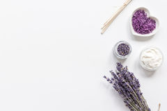 Lavender flowers in organic cosmetic set on white background top view mock-up. Lavender flowers in organic cosmetic set with herbs on white table background top stock photo