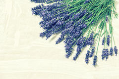 Lavender flowers over rustic wooden background. Vintage style Stock Photos
