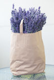 Lavender flowers picked up. Paper pack full of lavender flowers picked up. Summer time and harvest concept Stock Images