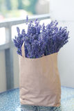 Lavender flowers picked up. Paper pack full of lavender flowers picked up. Summer time and harvest concept Stock Photo