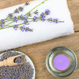 Lavender flowers, scented candles and towels Stock Photography