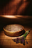 Lavender Flowers and Seeds in Wood Bowl in a Spa Stock Photos