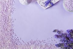 Lavender flowers, soap, aromatic sea salt and towels. Concept for spa, beauty and health salon, cosmetics store. Natural cosmetics. Close up, top view photo on royalty free stock images