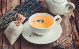 Lavender flowers, tea in cup, teapot and sachet. Royalty Free Stock Images
