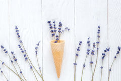 Lavender flowers with waffle cone mockup on white desk background top view. Lavender flowers bouquet with waffle cone mockup on white desk background top view Royalty Free Stock Photo