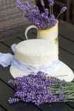 Lavender flowers and white hat on black table Royalty Free Stock Photography