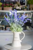Lavender flowers in white vase used for home decoration. On blur background stock photography