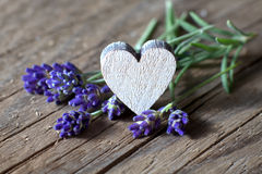 Lavender flowers and a wooden heart Stock Photos