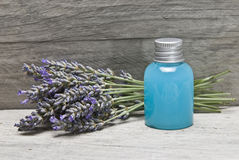 Lavender gel on a shelf. Lavender and some hygiene items made of lavender on an old wooden shelf royalty free stock photo
