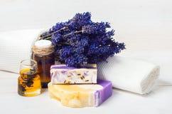 Lavender handmade soap,oil. Spa concept. Lavender handmade soap and accessories for body care (lavender, soap, towel, sponge, sea salt royalty free stock image