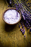 Lavender herb and salt. A bowl with lavender salt and herb French lavender over old wooden background with copy space royalty free stock photos