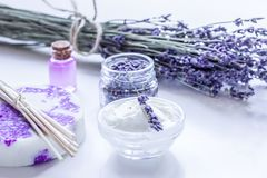 Lavender herbs in body care cosmetics with oil on white table ba. Lavender herbs in body care cosmetics with aroma oil on white table background Royalty Free Stock Image