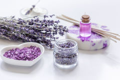 Lavender herbs in body care cosmetics with oil on white table background Stock Photos
