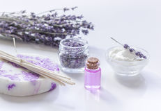 Lavender herbs in body care cosmetics with oil on white table background Stock Photography