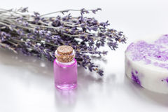 Lavender herbs in body care cosmetics with oil on white table background. Lavender herbs in body care cosmetics with aroma oil on white table background Stock Images