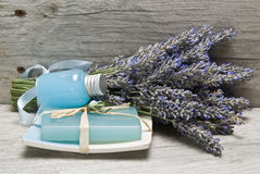 Lavender, and hygiene items. Lavender and some hygiene items made of lavender on an old wooden shelf Stock Image
