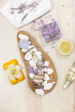 Lavender and lemon aromatherapy. Natural handmade lavender oil, soaps with bath salt, foaming bath bomb, lemon and lavender on wooden background Stock Images