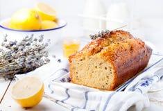 Lavender, lemon cake with fresh lemons and lavender flowers Royalty Free Stock Photo