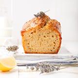 Lavender, lemon cake with fresh lemons and lavender flowers Stock Image