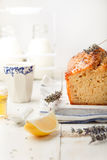 Lavender, lemon cake with fresh lemons and lavender flowers Stock Photo