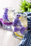 Lavender lemonade drink in jar on white wood royalty free stock image