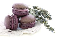 Lavender macaroons on linen napkin. Royalty Free Stock Photography