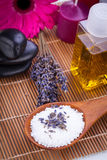Lavender massage oil and bath salt aroma therapy wellness. Beauty spa objects stock photography