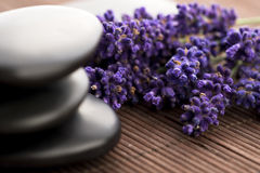 Lavender and massage stones Royalty Free Stock Photo