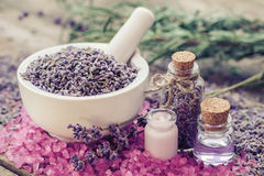 Lavender in mortar, aromatic sea salt, cream and bottles Stock Image
