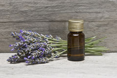 Lavender oil. Lavender and some hygiene items made of lavender on an old wooden shelf stock images