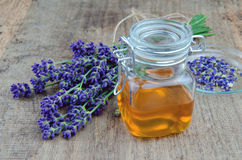 Lavender oil. On a wooden background Stock Image