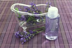 Lavender oil bath with flowers and leaves Royalty Free Stock Images
