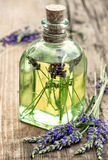 Lavender oil with fresh flowers. Healthy herbs Stock Photos